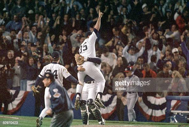 John Wetteland of the New York Yankees celebrates the final out of Game six of the 1996 World Series against the Atlanta Braves at Yankee Stadium on...