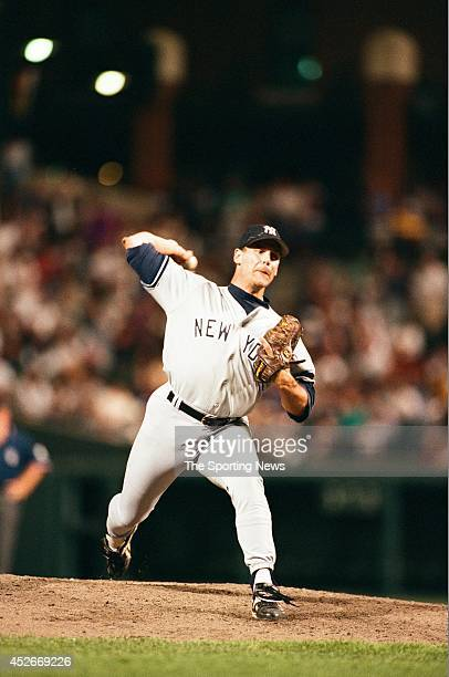 John Wetteland of the New York Yankees pitches against the Baltimore Orioles during a game at Oriole Park at Camden Yards on July 11 1996 in...