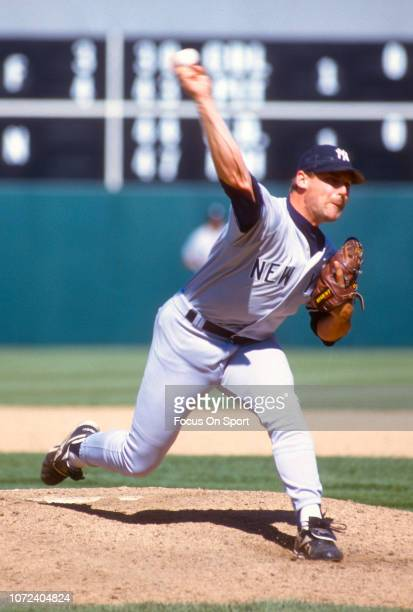 John Wetteland of the New York Yankees pitches against the Oakland Athletics during an Major League Baseball game circa 1995 at the OaklandAlameda...