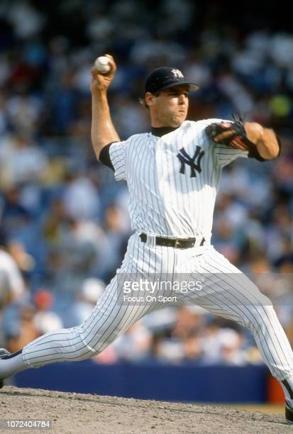 John Wetteland of the New York Yankees pitches during an Major League Baseball game circa 1995 at Yankee Stadium in the Bronx borough of New York...