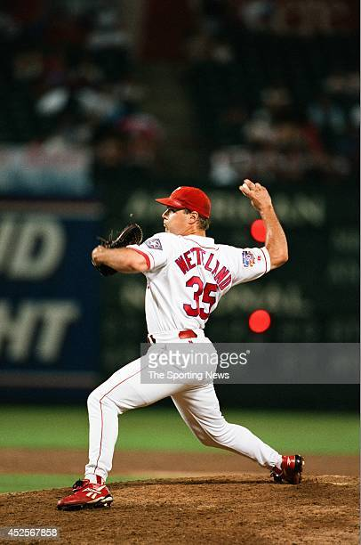 John Wetteland of the Texas Rangers pitches against the New York Yankees at Rangers Ballpark on August 6 1997 in Arlington Texas The Rangers defeated...