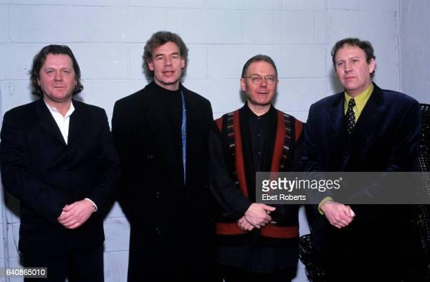 John Wetton Bill Bruford Robert Fripp and David Cross of King Crimson photographed at HMV record store in New York City on January 17 1997