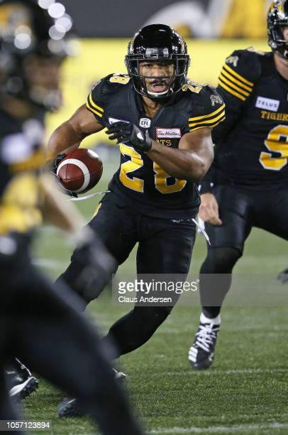 John White of the Hamilton TigerCats runs the ball against the Montreal Alouettes in a CFL game at Tim Hortons Field on November 3 2018 in Hamilton...
