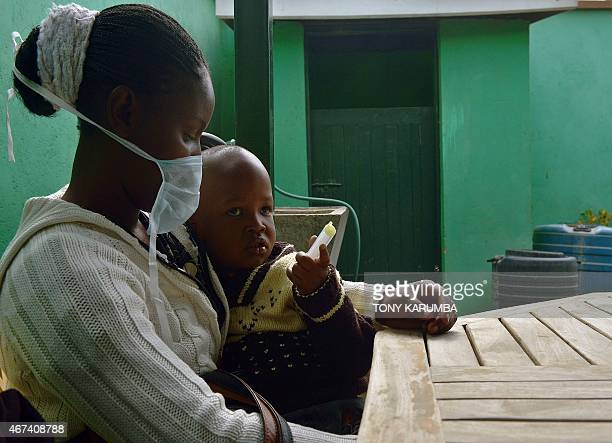 John who suffers from multidrugresistant tubeculosis is held by his mother Elizabeth also an MDRTB case after she gave him his medication at a...