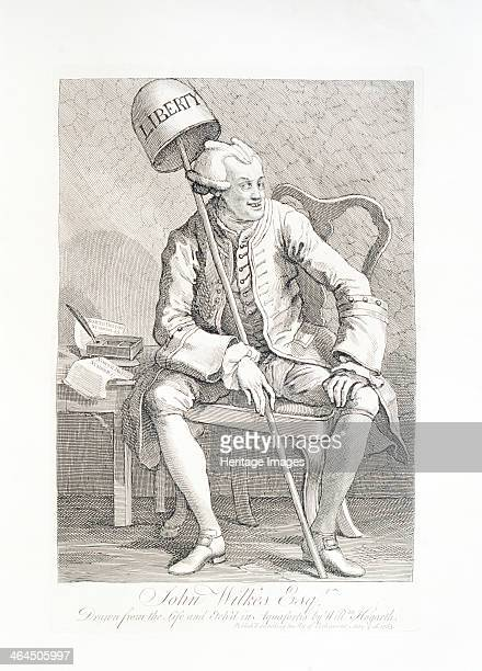 John Wilkes 1763 Wilkes is wearing a wig that Hogarth has fashioned into two horns He holds a cap entitled liberty that Hogarth has positioned to...