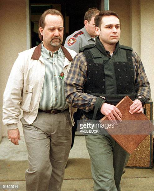 John William Bill King is escorted by Southeast Texas Narcotics Task Force Commander Glen Smith from the Jasper County Courthouse following day eight...
