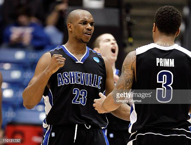 John Williams and JP Primm of the North CarolinaAsheville Bulldogs celebrate after a play in the second half against the Arkansas Little Rock Trojans...