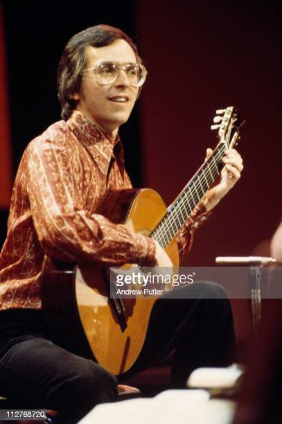 John Williams Australian classical guitarist playing the guitar during a live concert performance circa 1970