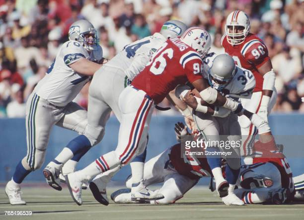 John Williams Fullback for the Seattle Seahawks tries to run the ball through John Williams Defensive End for the New England Patriots during their...