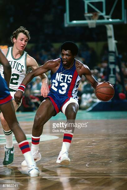 John Williamson of the New Jersey Nets moves the ball against Jeff Judkins of the Boston Celtics during a game played in 1979 at the Boston Garden in...