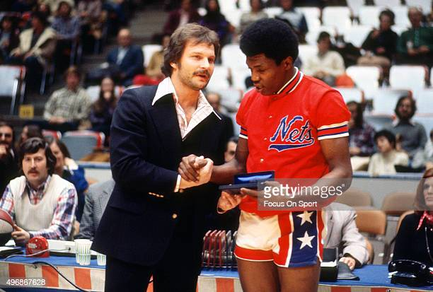 John Williamson of the New York Nets is seen prior to the start of an ABA basketball game circa 1974 at the Nassau Veterans Memorial Coliseum in...