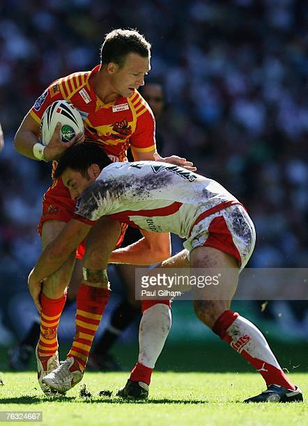 John Wilson of Catalans is tackled by James Roby of StHelens during the Carnegie Challenge Cup Final between StHelens and Catalans Dragons at Wembley...
