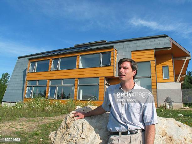 John Wilson outside and inside his Natural Home a monument to sustainable living at 248108 No 5 Sideroad in the Town of Mono north of Highway 9 and...