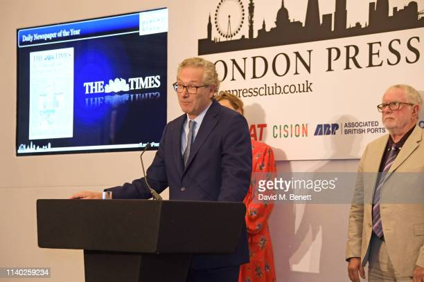 John Witherow accepting the Daily Newspaper of the Year award on behalf of The Times and Bill Hagerty attend the London Press Club Awards 2019 at...