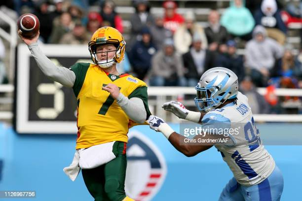 John Wolford of Arizona Hotshots attempts a pass as Chris Odom of Salt Lake Stallions grabs him during their Alliance of American Football game at...
