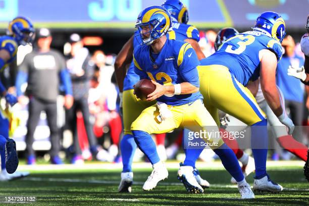 John Wolford of the Los Angeles Rams in action during a game against the New York Giants at MetLife Stadium on October 17, 2021 in East Rutherford,...