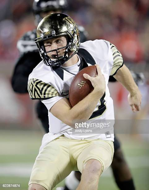 John Wolford of the Wake Forest Deamon Deacons runs with the ball during the game against the Louisville Cardinals at Papa John's Cardinal Stadium on...