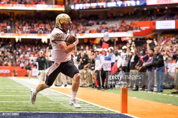 John Wolford of the Wake Forest Demon Deacons carries the ball for a touchdown during the first quarter against the Syracuse Orange at the Carrier...