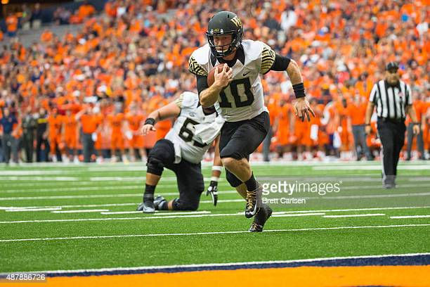 John Wolford of the Wake Forest Demon Deacons carries the ball in for a touchdown during the second quarter making the score 1413 over Syracuse...