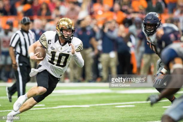 John Wolford of the Wake Forest Demon Deacons carries the ball on fourth down for a 29 yard touchdown against the Syracuse Orange during the fourth...