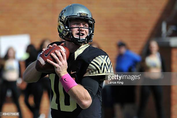 John Wolford of the Wake Forest Demon Deacons drops back to pass against the North Carolina State Wolfpack at BBT Field on October 24 2015 in...