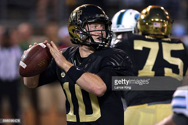 John Wolford of the Wake Forest Demon Deacons drops back to pass against the Tulane Green Wave at BBT Field on September 1 2016 in WinstonSalem North...