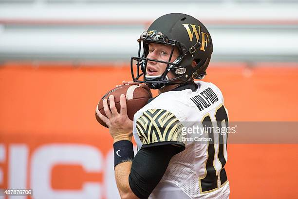 John Wolford of the Wake Forest Demon Deacons warms up before the game against the Syracuse Orange on September 12 2015 at The Carrier Dome in...