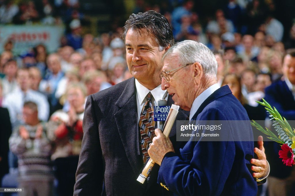 John Wooden and Gail Goodrich hug during Gail Goodrich's Jersey Retirement prior to a game between th Los Angeles Lakers and the Utah Jazz on November 20, 1996 at the Great Western Forum in Inglewood, California.