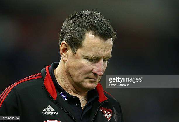 John Worsfold coach of the Bombers leaves the field dejected after losing the round 18 AFL match between the Essendon Bombers and the Brisbane Lions...