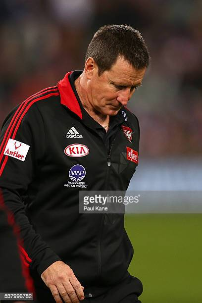 John Worsfold coach of the Bombers walks from the field after the three quarter time break during the round 11 AFL match between the Fremantle...