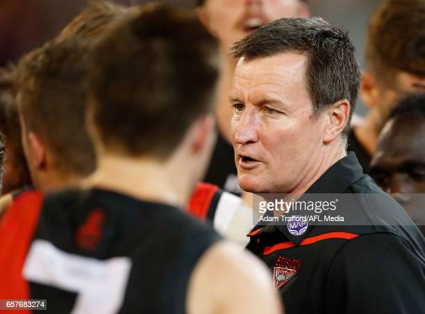 John Worsfold Senior Coach of the Bombers addresses his players during the 2017 AFL round 01 match between the Essendon Bombers and the Hawthorn...