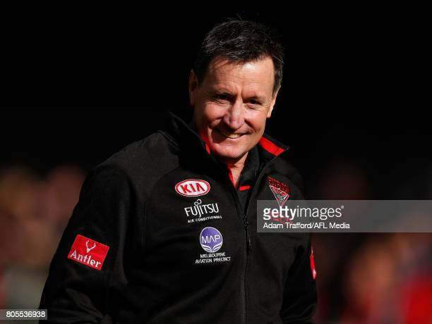 John Worsfold Senior Coach of the Bombers looks on during the 2017 AFL round 15 match between the Essendon Bombers and the Brisbane Lions at Etihad...