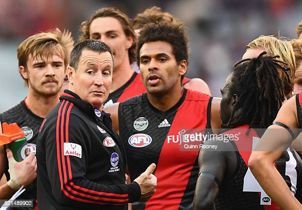 John Worsfold the coach of the Bombers talks to his players during the round four AFL match between the Essendon Bombers and the Geelong Cats at...