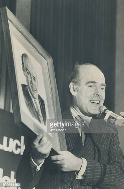 John Worsley with portrait by Irma Coocill given to him at UA luncheon at Royal York Other pic shows Worsley with wifo admiring portrait