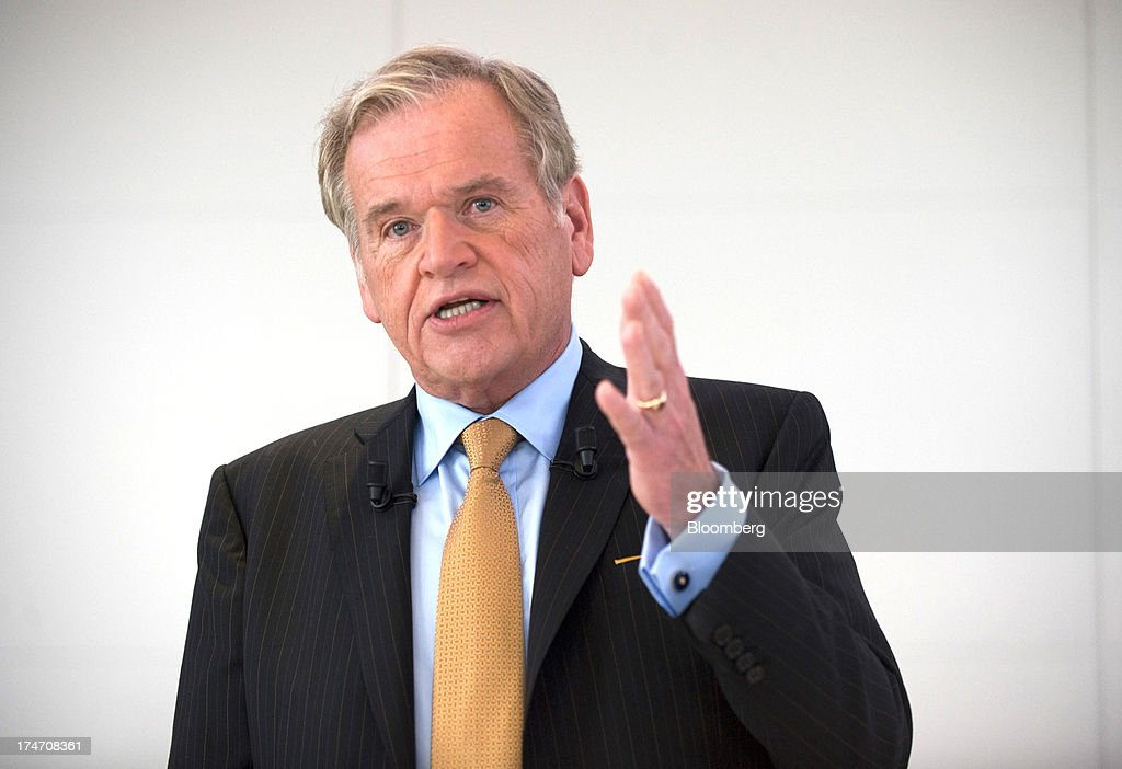 John Wren, chief executive officer of Omnicom Group Inc., reacts during a news conference at the Publicis headquarters in Paris, France, on Sunday, July 28, 2013. Publicis Groupe SA and Omnicom Group Inc. agreed to merge in an all-stock transaction to create the world's largest advertising company with $23 billion in revenue, toppling market leader WPP Plc. Photographer: Balint Porneczi/Bloomberg via Getty Images