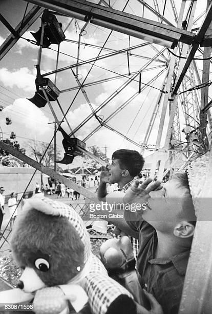 John Wulzik left and Joseph Queena right both of Lynn Mass enjoy the Topsfield Fair in Topsfield Mass on Sept 3 1968