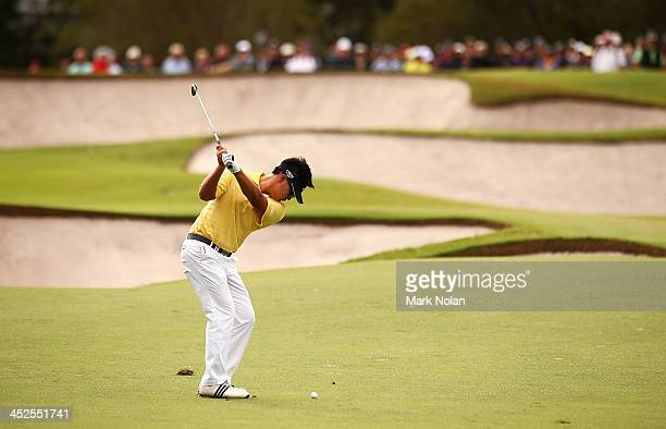 John Young Kim of the USA plays an approach shot during day three of the Australian Open at Royal Sydney Golf Club on November 30 2013 in Sydney...