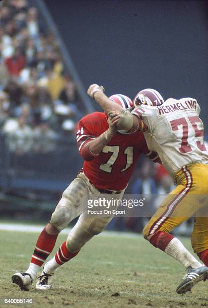 John Zook of the Atlanta Falcons gets blocked by Terry Hermeling of the Washington Redskins during an NFL football game December 7 1975 at...