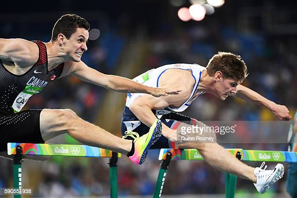 Johnathan Cabral of Canada and Lawrence Clarke of Great Britain compete in the Men's 110m Hurdles Semifinals on Day 11 of the Rio 2016 Olympic Games...