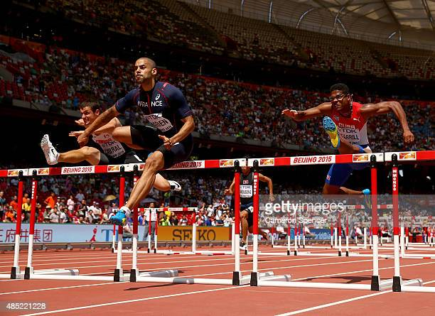 Johnathan Cabral of Canada Garfield Darien of France and Yordan L O'Farrill of Cuba compete in the Men's 110 metres hurdles heats during day five of...