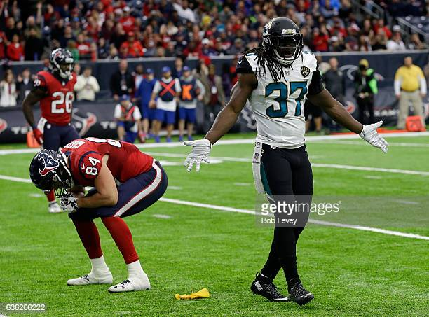 Johnathan Cyprien of the Jacksonville Jaguars disagrees with the pass interference call on Ryan Griffin of the Houston Texans at NRG Stadium on...