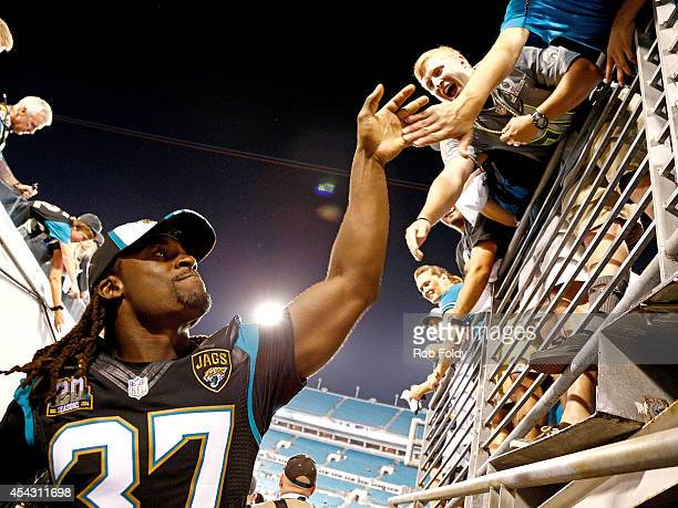 Johnathan Cyprien of the Jacksonville Jaguars interacts with fans while leaving the field after the game against the Atlanta Falcons at EverBank...