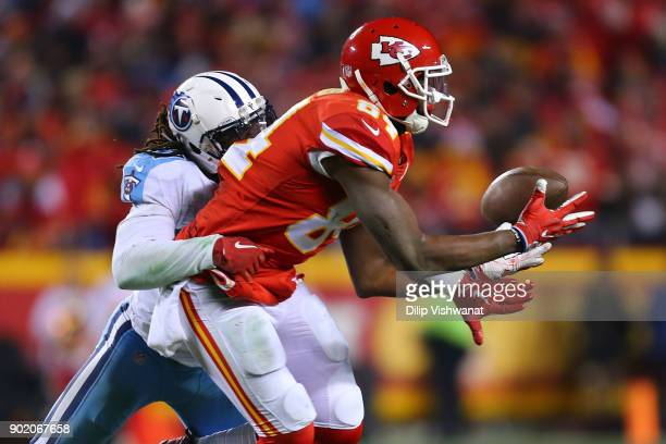 Johnathan Cyprien of the Tennessee Titans breaks up a pass intended for Demetrius Harris of the Kansas City Chiefs during the AFC Wild Card playoff...