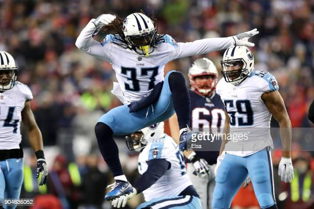 Johnathan Cyprien of the Tennessee Titans celebrates a tackle during hte first quarter against the New England Patriots in the AFC Divisional Playoff...
