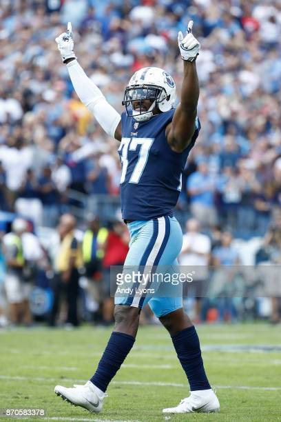 Johnathan Cyprien of the Tennessee Titans celebrates after a interception against the Baltimore Ravens during the first half at Nissan Stadium on...