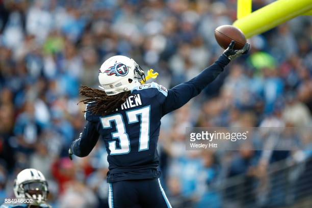 Johnathan Cyprien of the Tennessee Titans celebrates after a interception in the closing minute against the Houston Texans during the second half at...