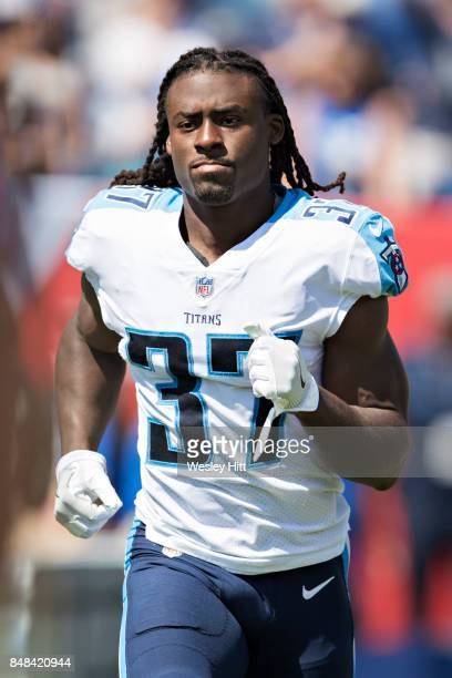 Johnathan Cyprien of the Tennessee Titans runs onto the field before a game against the Oakland Raiders at Nissan Stadium on September 10 2017 in...