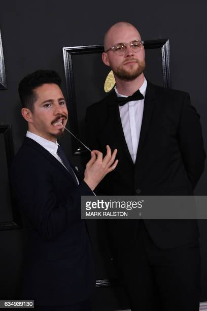 Johnathan Dagan and Mathais Host arrive for the 59th Grammy Awards pretelecast on February 12 in Los Angeles California / AFP / Mark RALSTON