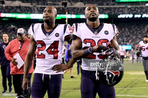 Johnathan Joseph and Andre Hal of the Houston Texans react after their teams win over the New York Jets at MetLife Stadium on December 15, 2018 in...