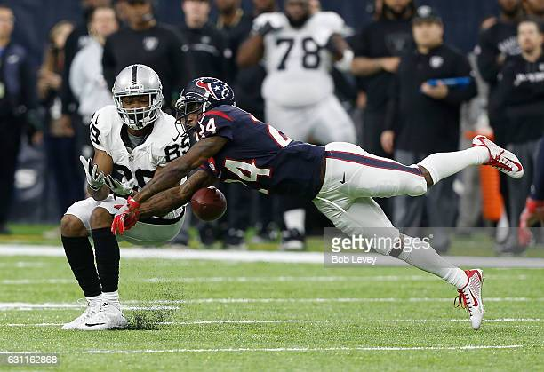 Johnathan Joseph of the Houston Texans breaks up a pass to Amari Cooper of the Oakland Raiders during the first half of their AFC Wild Card game at...